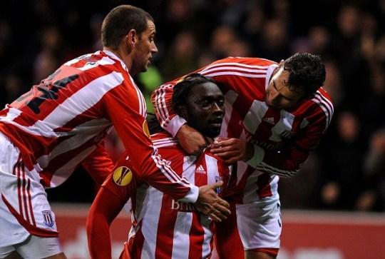 Kenwyne Jones, centre, celebrates his late equaliser with team-mates Rory Delap, left, and Danny Higginbotham