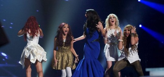 Little Mix and judge Tulisa Contostavlos were beside themselves when they heard they had won this year's X Factor. (Picture: Rex)