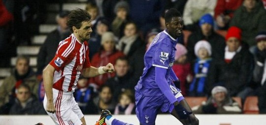 Stoke City's Jonathan Woodgate vies for the ball against Tottenham's Emmanuel Adebayor