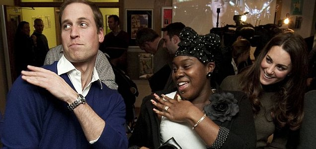 Prince William dances with Vanessa Boateng  as his wife Catherine looks on