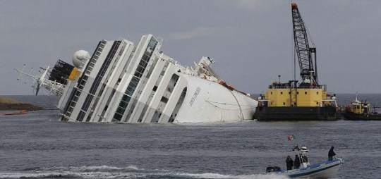 An oil recovery sea platform next to the Costa Concordia