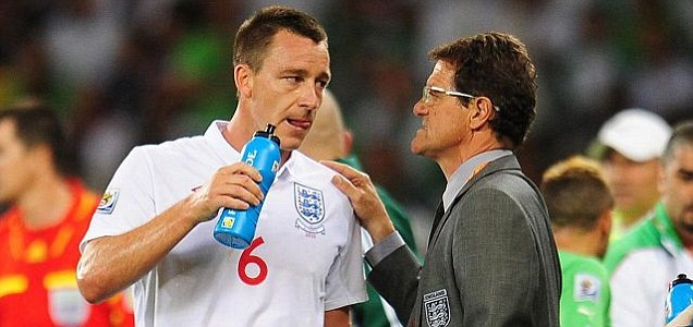 England manager Fabio Capello speaking to John Terry
