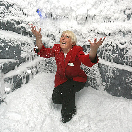Chilling out: Redcoat Christina Holder gets her hands full of snow in the Ocean Hotel's snow cave