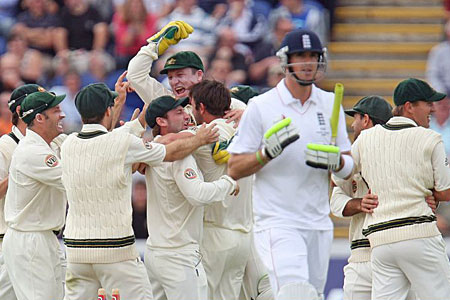 Starting the rot: England's Kevin Pietersen trudges off after being bowled by a delighted Ben Hilfenhaus