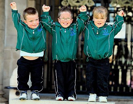 Athletes Shane McAnulty, 8, Andrew Moorcroft, 10, and Emma Fitzsimons, 8