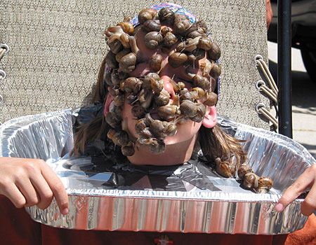 Fin Keheler attempting to break the world record for the number of snails placed on the face for 10 seconds