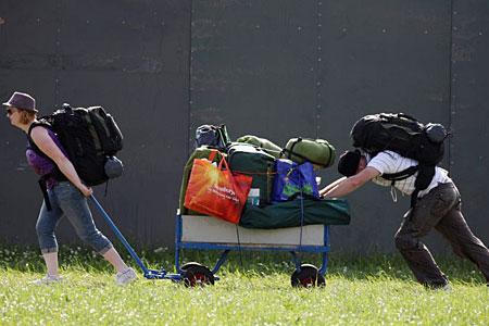 Two festival goers arrive at Glastonbury