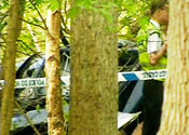 Police tape off the scene of the crash
