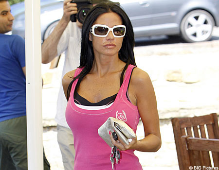 Back home: Jordan chills out back at her Sussex stables after her Ibiza blowout