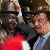 Comedian Ken Dodd unveils a statue of of Laurel and Hardy in Ulverston, Cumbria