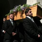 The coffin of Sir Clement Freud is carried to St Bride's Church in Fleet Street