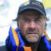 Sir Ranulph Fiennes has reached the summit of Everest at third attempt