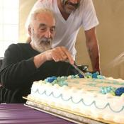 Christopher Lee was presented with the cake by cast and crew