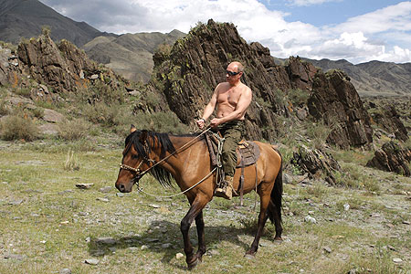 From Russia with love: Macho man Vladimir Putin goes topless while riding a horse