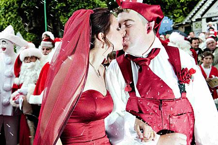 A kiss to seal the Santa deal: World Santa Claus Congress opens in Denmark