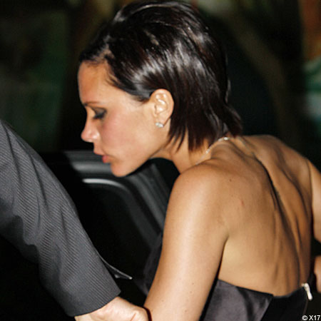 Victoria Beckham slips into the back of a car following the night out