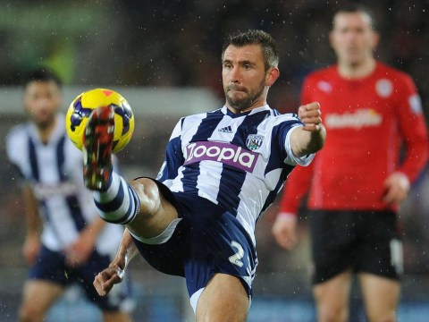 Gareth McAuley finds the target as he smashes press laptop at Norwich