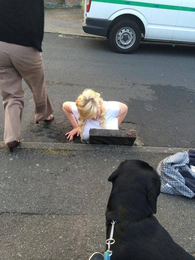 Ella Birchenough being rescued by firefighters after getting stuck in a storm drain while trying to retrieve her mobile phone in Dover, Kent