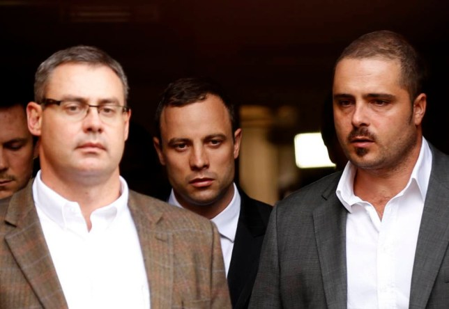 Sombre: The strain shows on the face  of Oscar Pistorius as he leaves court yesterday after a bruising cross-examination by prosecutor Gerrie Nel (Picture: Reuters)
