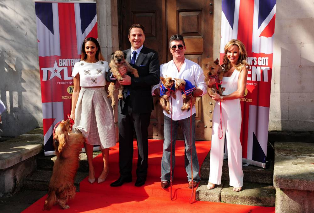 (left to right) Alesha Dixon, David Walliams with his dog Bert, Simon Cowell with his dogs Squiddly and Diddly and Amanda Holden attending a press launch for Britain's Got Talent at LSO St Luke's in London. PRESS ASSOCIATION Photo. Picture date: Wednesday April 9, 2014. Photo credit should read: Ian West/PA Wire