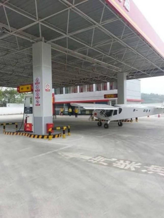 """Chinese police are trying to hunt down a man they suspect of being a foreign pilot who, when he ran out of fuel in the county of Beichuan in southwest China¿s Sichuan province, simply landed on the road and drove into a nearby petrol station to tank up.nnThe plane, which appeared to be home-made, taxied into the petrol station alongside other cars that were waiting to fill up, and then with the help of petrol station staff the pilot managed to pull out one of the petrol pump nozzles far enough to fill up the machine with fuel. To do so he clambered on one of the wings to reach the fuel cap.nnA police spokesman confirmed: """"We had a call that there was a plane driving down the road but we don't know if it had actually been flying and had landed or whether it was just some sort of stunt from somebody who had created this vehicle in order to drive down the road and attract attention.nn""""The man told petrol station staff he had landed because he had run out of fuel, and we have spoken to one driver who said they saw the plane land, but if that's the case it is a mystery why we haven't been able to locate the landing field where it took off from or landed or indeed the pilot.""""nnLiu Yongbi, 35, was the petrol station attendant who had been cleaning the forecourt when the plane taxied in, and he told police that there were two people inside, a foreigner and a Chinese man. He said he had complimented them on the plane and added: """"They told me it was practical and they didn't have to worry about traffic jams, but had discovered refuelling was a problem.""""nnHe said the men had told him that the plane had cost them 200,000 GBP, the same price as a luxury car, and after ten minutes refuelling they paid the petrol price and drove off.n"""