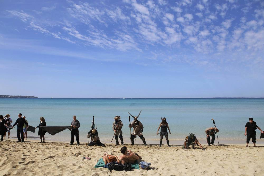 Pictures: Not your average day at the beach as protesters dress as devils