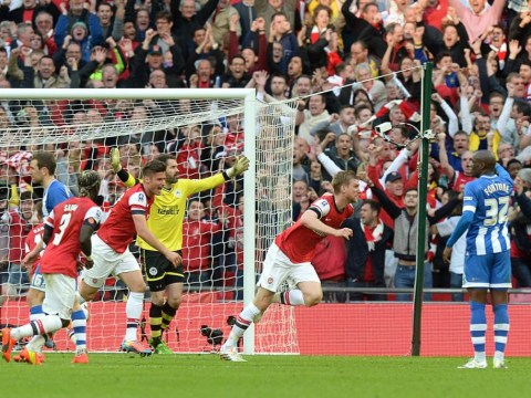 Per Mertesacker makes amends for earlier error as he pulls Arsenal level against Wigan