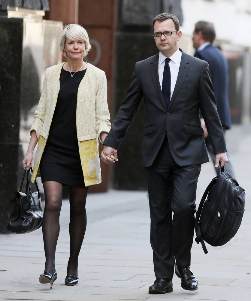 Giving evidence: Former NotW editor Andy Coulson arrives at the Old Bailey holding his wife's hand (Picture: Reuters)