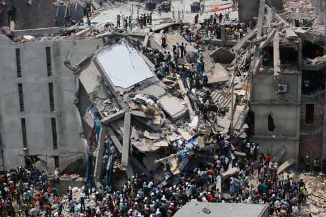 RNPS - PICTURES OF THE YEAR 2013 - People rescue garment workers trapped under rubble at the Rana Plaza building after it collapsed, in Savar, 30 km (19 miles) outside Dhaka April 24, 2013. An eight-storey block housing garment factories and a shopping centre collapsed on the outskirts of the Bangladeshi capital, killing at least 25 people and injuring more than 500, the Ntv television news channel reported. REUTERS/Andrew Biraj (BANGLADESH - Tags: DISASTER BUSINESS TPX)