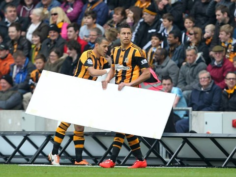 Arsenal clash with Hull City disrupted by pitch-invading advertising boards