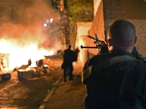 Riots erupt in Rio as police blamed over favela killing