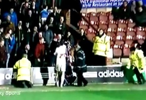 Crawley defender Paul Connolly slaps Brentford fan – VIDEO