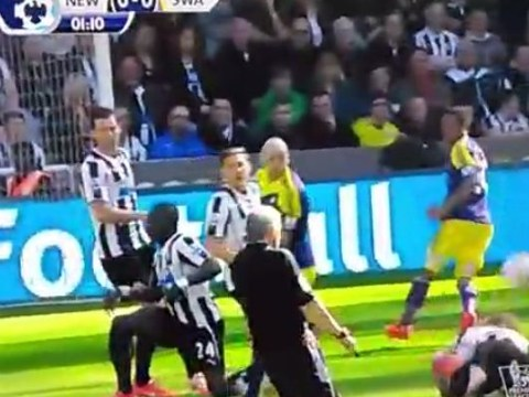 Referee Chris Foy flattened after Jonjo Shelvey shots deflects into his face