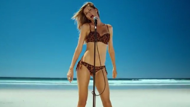 Gisele multi-tasks with some decent singing in her leopard print H&M bikini (Picture: H&M)
