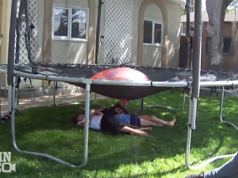 Kids drenched with water as dad plays cruel but enormously funny trampoline prank