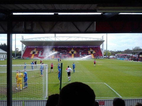 Woking's match against Alfreton Town halted as sprinklers come on mid-game