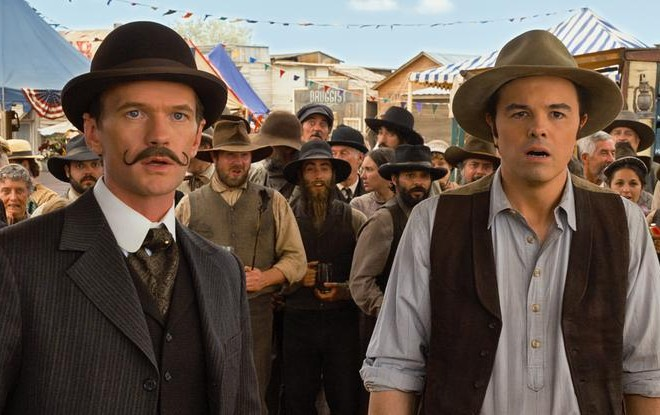 "Neil Patrick Harris, left, and Seth MacFarlane in a scene from ""A Million Ways to Die in the West."" (AP Photo/Universal Pictures)"