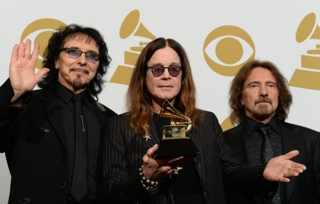 Tony Iommi (L), Ozzy Osbourne (C) and Geezer Butler (R) of Black Sabbath pose in the press room after winning Best Metal Performance for 'God is Dead?' during the 56th Grammy Awards at the Staples Center in Los Angeles, California, January 26, 2014. AFP PHOTO / JOE KLAMAR JOE KLAMAR/AFP/Getty Images