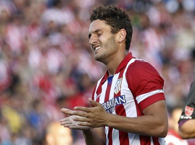 Atletico Madrid's midfielder Koke reacts during the Spanish league football match Club Atletico de Madrid vs Malaga CF at the Vicente Calderon stadium in Madrid on May 11, 2014. The match ended in a 1-1 draw. AFP PHOTO / ALBERTO DI LOLLI ALBERTO DI LOLLI/AFP/Getty Images