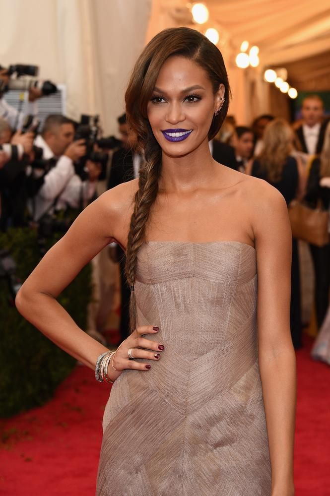 Model Joan Smalls went for a very bold lip on the Met Gala red carpet, along with her Vera Wang dress (Picture: Larry Busacca/Getty Images)