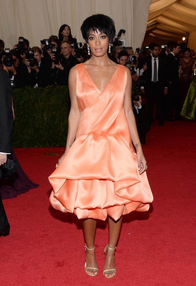 "FILE - This May 5, 2014 file photo shows Solange Knowles, sister of Beyonce Knowles, at The Metropolitan Museum of Art's Costume Institute benefit gala celebrating ""Charles James: Beyond Fashion"" in New York. The Standard Hotel in New York City says it is investigating the leak of a security video that appears to show Beyonce's sister, Solange, attacking Jay Z. Asked about the video on Monday, May 12, by The Associated Press, the hotel issued a statement saying it is ""shocked and disappointed that there was a clear breach of our security system."" (Photo by Evan Agostini/Invision/AP) Evan Agostini/Invision/AP"