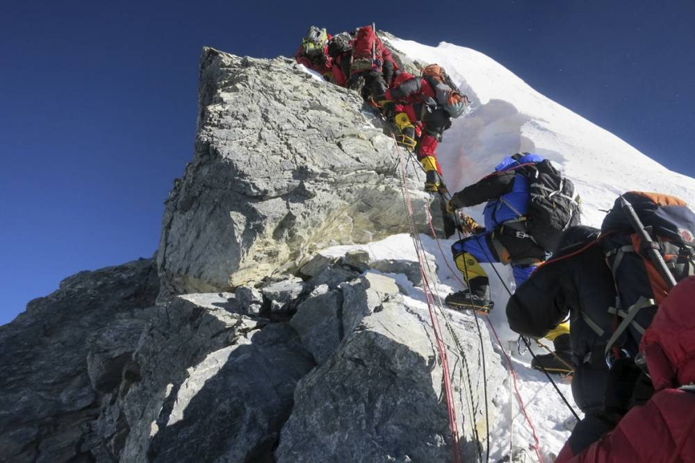 Climber 'cheats' at record Mount Everest ascent by 'riding helicopter to the top'