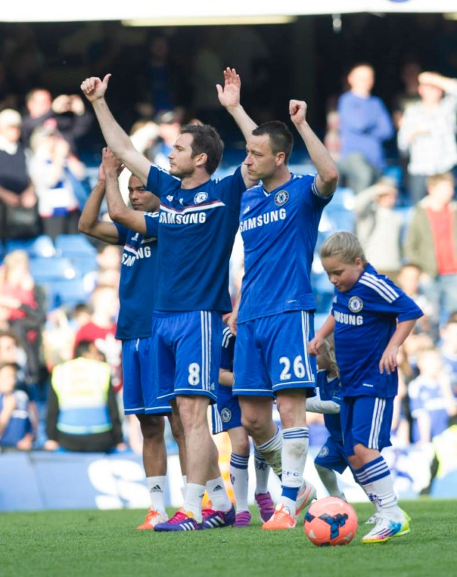 Chelsea's John Terry, right, Frank Lampard, center, and Joe Cole salute the fans as they walk around the pitch with their children at the end of their English Premier League soccer match against Norwich City, at the Stamford Bridge Stadium in London, Sunday, May 4, 2014. (AP Photo/Bogdan Maran)