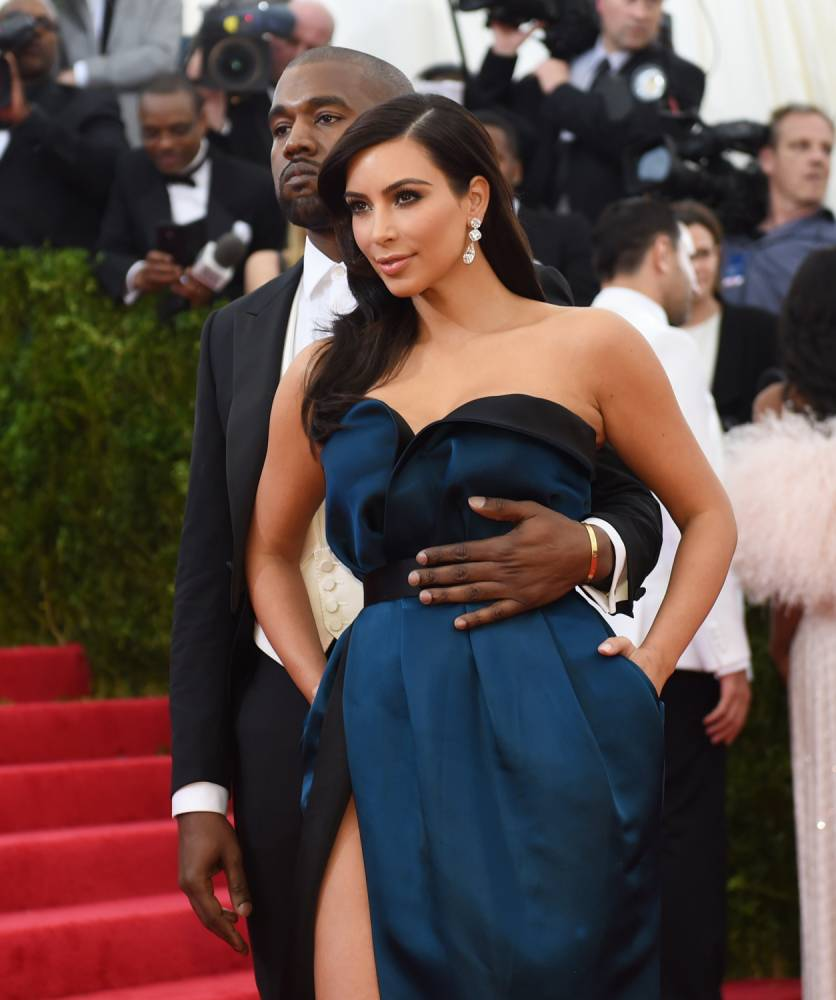 Kanye West (L) and Kim Kardashian (R) arrive at the Costume Institute Benefit at The Metropolitan Museum of Art May 5, 2014 in New York. AFP PHOTO/Timothy A. CLARYTIMOTHY A. CLARY/AFP/Getty Images