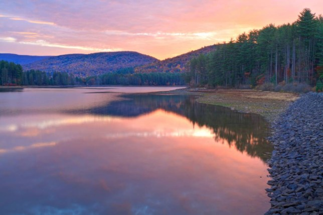 Colorful sunrise on Cooper Lake in Autumn, in the Catskills Mountains near Woodstock, New York