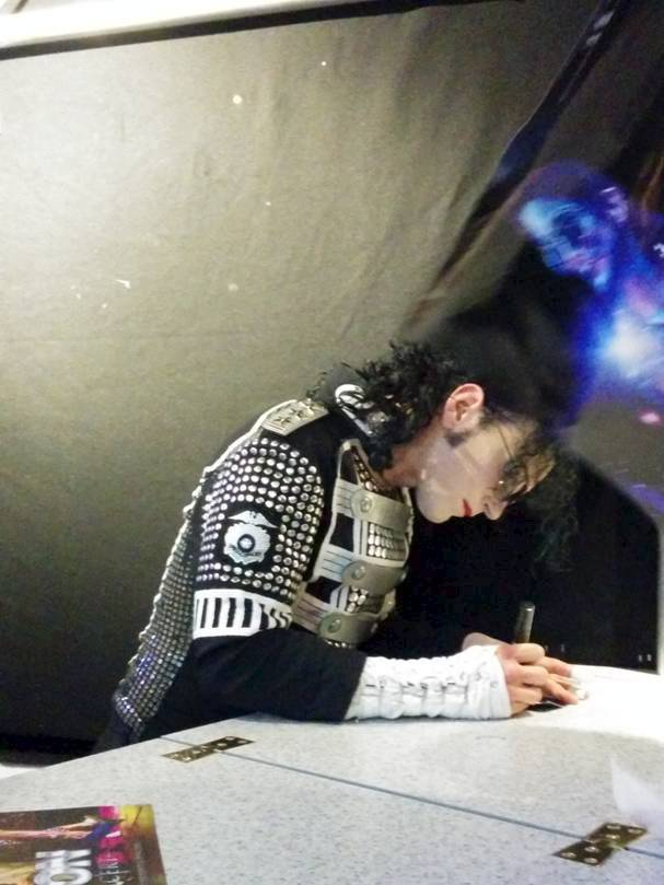 He wants to Rock With You: This picture apparently shows the ghost of Michael Jackson leaning over a king of pop impersonator (Picture: Cascade)