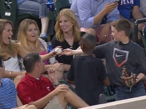 Young baseball fan woos girl with the smoothest play of the game