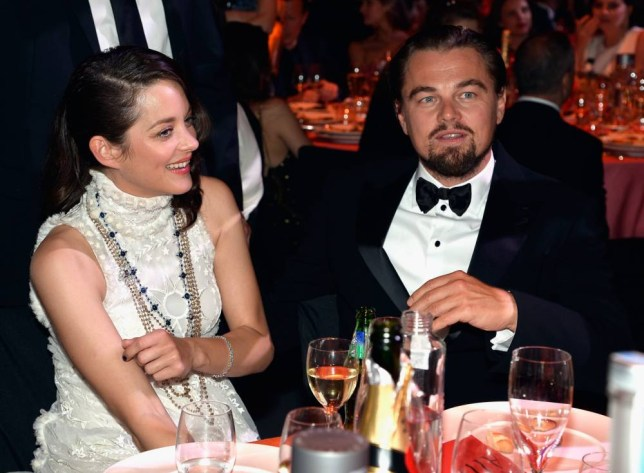 Leo's like a kid on Christmas morning with all those supermodels (Picture: Pascal Le Segretain/amfAR14/WireImage)