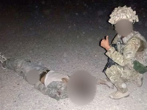 British soldiers' 'thumbs up' pictures with Taliban dead prompts RAF probe