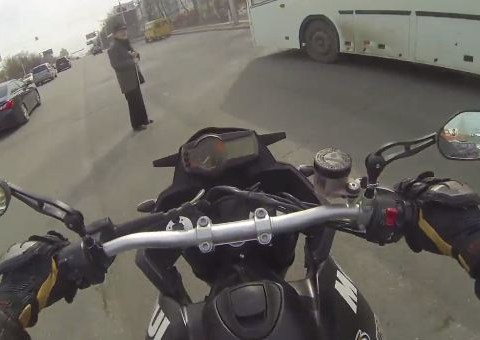 Video of motorcyclist guiding disabled man across a busy road will restore your faith in humanity